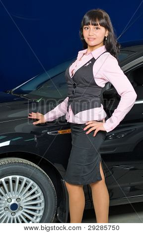 Businesswoman in car shop