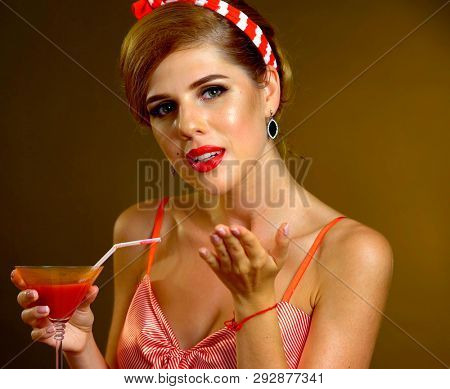 Pin up girl drink red