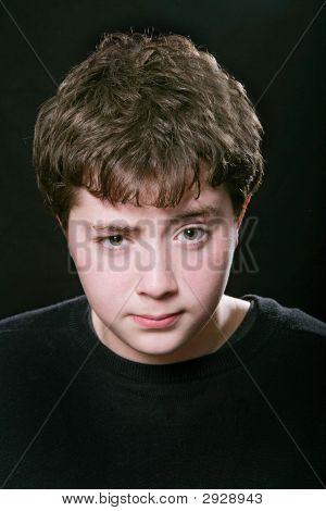 Skeptical Teen Boy Over Black