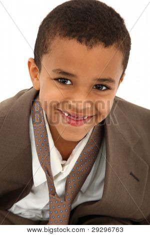 Portrait Of Boy Wearing Father's Suit And Tie Isolated On White Background