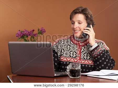 Attractive woman working at home in winter