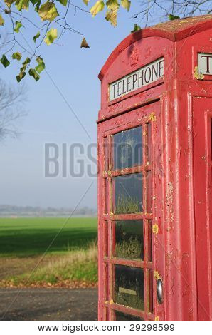 Red English Phone Booth In Countryside