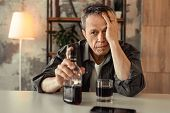 Desperate Old Alcoholic Sitting In Front Of Glass Bottle With Rom poster