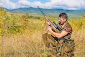 Hunter With Rifle Looking For Animal. Hunting Hobby And Leisure. Man Charging Hunting Rifle. Hunting poster