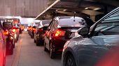 Transportation Vehicle And Traffic Concept - Blurred Traffic Jam And Car Brake Light In Bangkok, Tha poster
