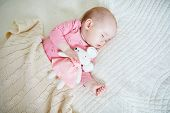 Baby Girl Having A Nap With Her Favorite Mouse Toy. Little Child Sleeping On Bed With Comforter. Sle poster
