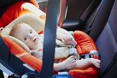 Adorable Baby Girl In Modern Car Seat. Little Kid Traveling By Car. Child Safety On The Road. Trip W poster