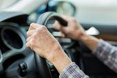 Senior man driving a car poster