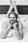 Morning Routine Tips To Feel Good All Day. Man Handsome Guy Lay In Bed In Morning. How To Get Up In  poster