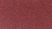 Red Sandpaper Paper Texture Or Paper Background. Seamless Paper For Design. Close-up Paper Texture F poster