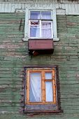 picture of murmansk  - Two windows on the wall of wooden house in Murmansk Russia - JPG