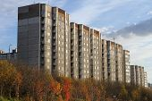 stock photo of murmansk  - Apartment buldings and trees in autumn Murmansk Russia - JPG