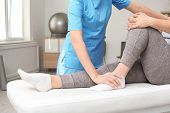 Physiotherapist Working With Patient In Clinic, Closeup. Rehabilitation Therapy poster