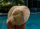 Woman relaxing in swimming pool at spa resort. relaxing concept. - UNRETOUCHED body. poster