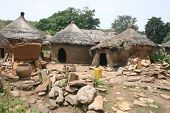 tupical west African village of mud and dung huts with thatched roofs in Benin, Africa