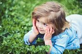Cute Child Smile On Green Grass Lawn. Little Girl Relax On Spring Or Summer Day Outdoor. New Life, Y poster