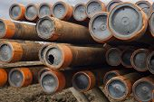 Oil Drill Pipe. Laid Out Drilling Pipes At A Well Site.well Drilling.drill Pipe Stacked On Pipe Deck poster