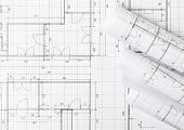 Rolls Of Architectural Blueprint House Building Plans On Blueprint Background On Table Flatlay Top V poster