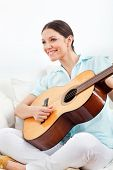 Elderly happy woman learning to play guitar