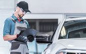 Certified Auto Service Worker Making Warranty Documentation. Vehicle Under Maintenance. Automotive C poster