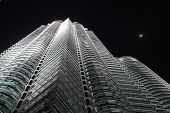 image of petronas towers  - One of the petronas towers at night taken from below - JPG