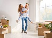 Happy young married couple are moving to new apartment. poster