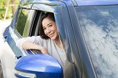 Young Asian Woman Driving A Car And Smile Happily With Glad Positive Expression During The Drive To  poster