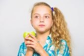 Apple A Day Keeps Doctor Away. Good Nutrition Is Essential To Good Health. Kid Girl Eat Green Apple  poster