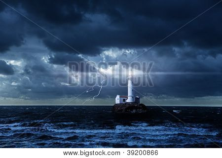 Lighthouse glowing at stormy night
