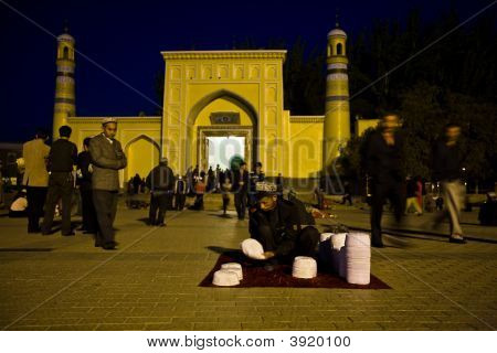 Man Selling Skull Caps In Front Of Mosque
