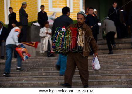 Man Selling Prayer Carpets At Mosque