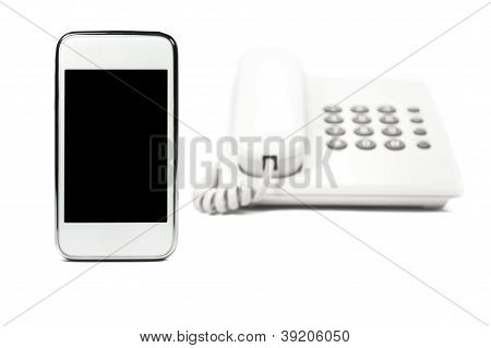Smartphone and telephone isolated on white