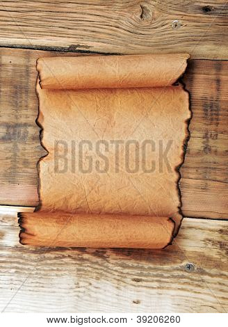 Paper scroll on wooden panel