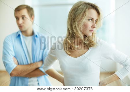 Image of young upset female in quarrel with her husband
