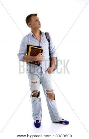 Full Body Pose Of Student Holding His Books