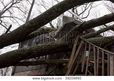 ANDOVER, NJ - OCT 30: Trees lay across the sundeck of a home after Hurricane Sandy made landfall in the northeast region of the US in Andover, New Jersey on October 30, 2012.