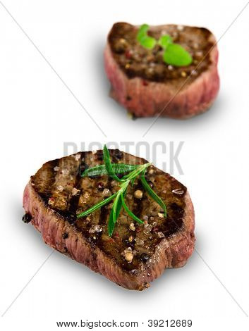 Grilled bbq steaks over white background