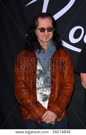 LOS ANGELES - NOV 20:  Geddy Lee of RUSH at the ceremony where RUSH is Inducted Into Guitar Center's RockWalk at Guitar Center on November 20, 2012 in Los Angeles, CA