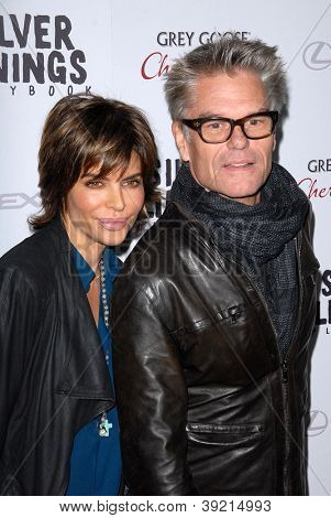 LOS ANGELES - NOV 19:  Lisa Rinna, Harry Hamlin arrives to the 'Silver Linings Playbook' LA Premiere at Academy of Motion Picture Arts and Sciences on November 19, 2012 in Beverly Hills, CA