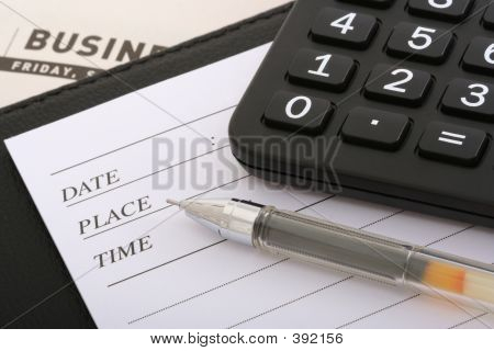 Ball Pen, Calculator And Notebook On Business File
