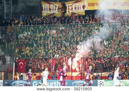 CLUJ-NAPOCA, ROMANIA - NOVEMBER 7: Galatasaray fans celebrating goal, UEFA Champions Leagu, CFR 1907 Cluj vs Galatasaray, Dr. C. Radulescu Stadium on 7 Nov., 2012 in Cluj-Napoca, Romania