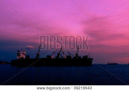 Dredge Sand Ship In Twilight