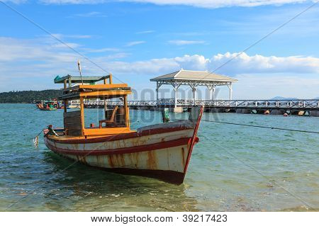 Boat Parking In The Sea With Bridge