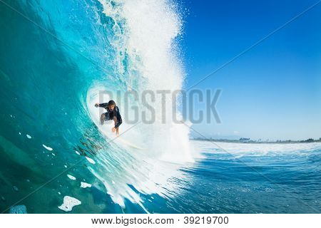 Surfer on Blue Ocean Wave in the Tube Getting Barreled