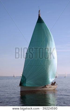 sailboat with green spinnaker
