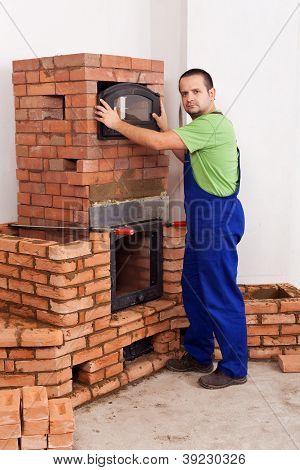Worker Building A Masonry Heater