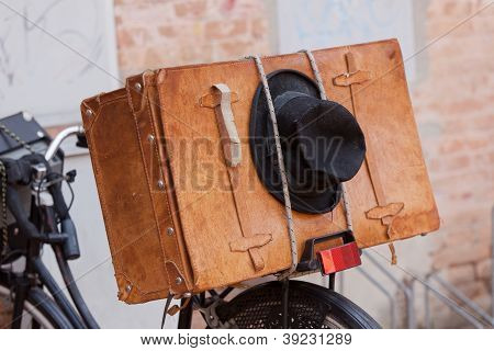 Shabby Black Hat And Brown Suitcase.
