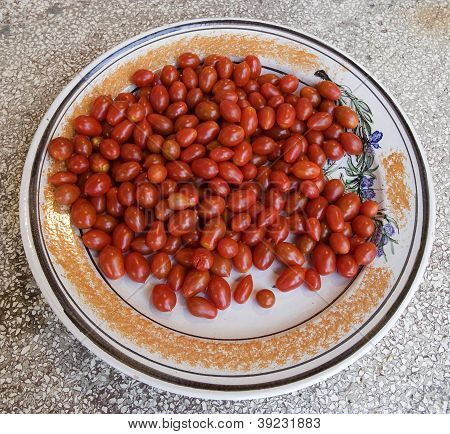 red tomato on typical ceramic dish
