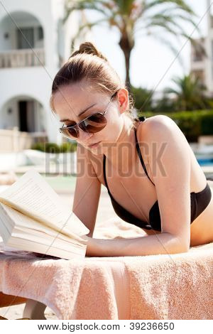 Sexy Woman In Bikini Relax On Sunlounger Sunbathing
