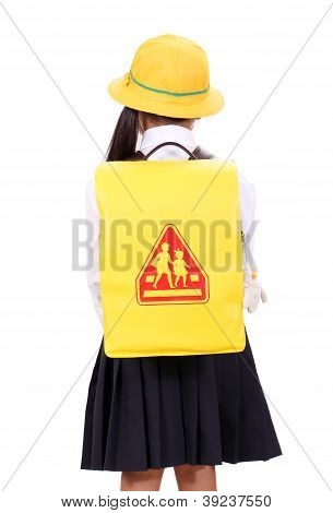 Rear view of little asian schoolgirl